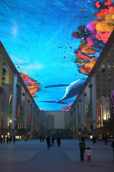 WOW World's Largest Virtual Fish Tank, 30 by 250 meters LED screen or 32 million dollar Virtual Aquarium mounted at about 80 feet in the air between two shopping malls in Beijing.