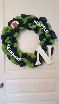 Seahawks wreath Seattle wreath, blue and green wreath.  Custom made by K's Handmade Gifts https://m.facebook.com/ksmonogramingandgifts/https://m.facebook.com/ksmonogramingandgifts/