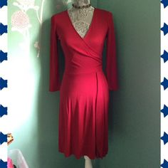 """Red Wrap Dress EUC Beautiful red stretch wrap dress by Ann Taylor Loft, Size 0. Excellent condition aside from 2 small areas of piling on the back, see right side of size photo. Side zip. Material tag is missing. There is some stretch to the dress. 38"""" long. Ann Taylor Dresses Long Sleeve"""