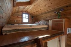 I love everything about this sleeping loft.....so cozy looking.