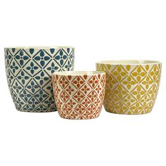 "Three-piece ceramic planter set.  Product: Small, medium and large planter   Construction Material: Ceramic       Color: Blue, orange and yellow  Features: Bold graphic patterns    Dimensions: Small: 6.75"" H x 8.5"" DiameterMedium: 8.5"" H x 10"" DiameterLarge: 10.75"" H x 12"" Diameter"