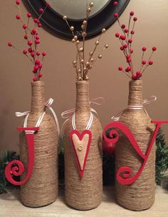 JOY Wine Bottle Decor by ChrissyLynnCreations on Etsy Could craft some sort of letters to hang on current wine bottles Glass Bottle Crafts, Wine Bottle Art, Diy Bottle, Vodka Bottle, Glass Bottles, Beer Bottle, Cork Crafts, Holiday Crafts, Recycled Wine Bottles
