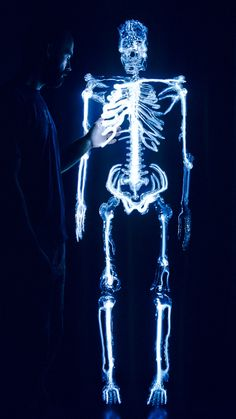 """""""Embodiment"""" is a stunning glass sculpture of a human skeleton that is brilliantly lit with krypton gas. The skulpture was created over the course of two years by artist Eric Franklin."""