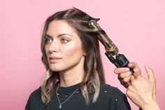 Grab a 1.5-inch curling iron, like the Hot Tools Big Bumper Curling Iron. (You can also use a wand, like John Frieda's Wavy Curls Iron, which Tran notes is easier for beginners to maneuver.) The goal is to create loose ringlets, without curling the roots or the ends of the hair. To do so, divide your locks into 1-inch sections and curl your hair in alternating directions