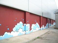 Pintura i dibuix manual de mur recinte