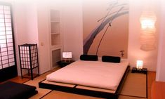 Japanese bedroom with futon bed, tatami mats, Japanese lantern, and Japanese sliding door.