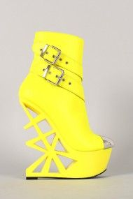 Privileged Stunna Wedge Bootie. Show off your fashionable look with this irresistible wedge bootie! Featuring a metallic accent at toe, bright neon leatherette upper, dual buckle strap detail, platform, and cut out wedge heel. Finished with cushioned insole, soft interior lining, and side zipper closure for easy on/off.
