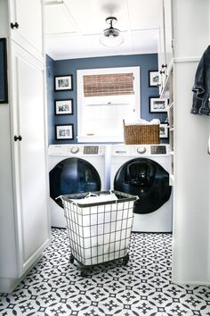 A dingy and dated laundry room gets a high contrast navy and white makeover packed with organizational strategies and budget-conscious DIY projects.