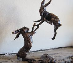 miniature bronze boxing hares statue by ginger rose | notonthehighstreet.com