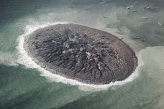 Pakistan's new 2013 mud volcano is spewing flammable gas. In this image you can also see the effects of the forces that gave rise to the island.
