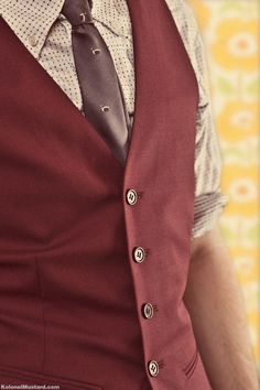 Burgundy waistcoat. Intriguing preference, waistcoat or vest? My preference leans towards waistcoat.