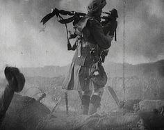 Scottish piper in a Kilt on the battlefield, World War One