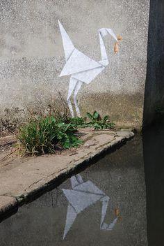 Origami crane and goldfish, Banksy