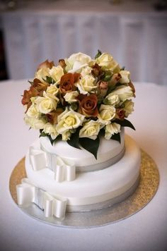 Cake with colour.... Stunning warm roses.. Contact: floralology@yahoo.com.au