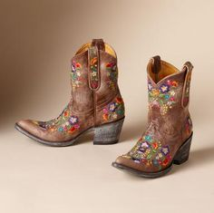 """FULL BLOSSOM BOOTS BY OLD GRINGO--Kick up your heels or kick back and prop your feet on the front porch railing. Old Gringo's artisanal boots are emblazoned with a freefall of embroidered flowers. Red boot, 1-1/2"""" canted heel"""