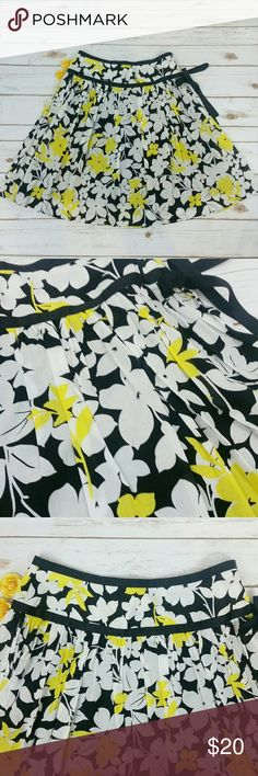 """Lapis yellow & white floral skirt This skirt is black with white and yellow flowers. It has a ribbon that ties on the side with a zipper. It is fully lined. Waist is approx 32"""", length is approx 23.5"""". All measurements taken unstretched. 100% cotton Lapis Skirts A-Line or Full"""