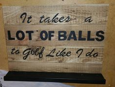 Golf ball holding sign