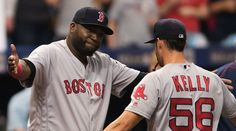 David Ortiz and Joe Kelly celebrate the Red Sox' latest win Sunday afternoon. (Kim Klement/USA Today Sports)