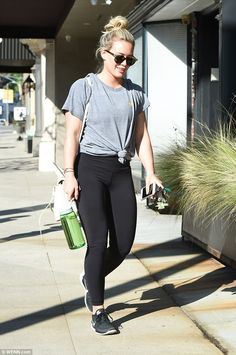 Ready to sweat: The beauty, who made her fame on TV series Lizzie McGuire, showed off her enviably toned figure as she headed to the gym in the form-fitting leggings and casual top