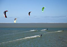 Kite surfing is a year round sport on South Padre Island, try your hand at riding the waves.