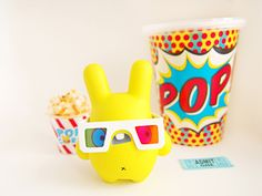 "Archie Archie loves 3D films, so much so he eats popcorn for breakfast and wears his 3D glasses day and night! This 3"" resin toy is a limited edition of 12. Each Archie comes in a gift box with a..."