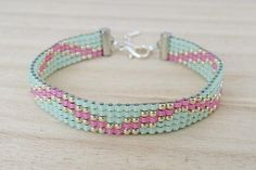 A pink and mint combination is very romantic! Handmade loom beaded bracelet is made with highest quality Japanese Toho seed beads of glass. These precision made seed beads are some of the finest in the world. Thats why Toho is called Eastern Treasure. Unique bracelet can be a great gift for your friend or for yourself! This is the ideal accessory to put the colorful beaded accent to your style with a boho touch. ◈ MATERIALS - Toho round glass seed beads in beautiful pink, mint and silver…