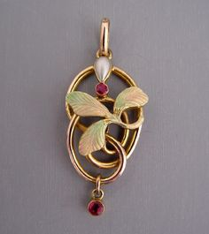 enameling on this is exquisite.  View  #Q24388    	    VICTORIAN 9 carat yellow gold and enamel pendant with garnets and pearl,