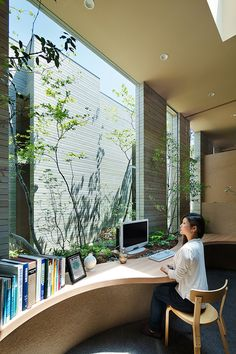 Keisuki Maeda designs building- - Sunlight is allowed inside the room to give life to the plants around you, even on your desk. But of course, it's done in way that won't discomfort you; in fact, it would inspire you more.