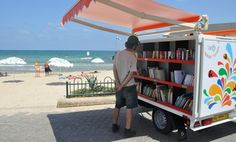 Mobile beach library in Tel Aviv, Israel, offering tourists the option to check-out books for free.