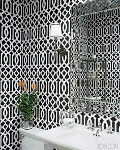 At her home in Bel Air, California, fashion designer Monique Lhuillier outfitted the powder room with a wallcovering by Astek.