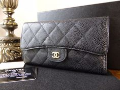 Chanel Classic Quilted Flap Continental Wallet in Black Caviar with Gold Hardware > https://www.npnbags.co.uk/naughtipidginsnestshop/prod_6066635-Chanel-Classic-Quilted-Flap-Continental-Wallet-in-Black-Caviar-with-Gold-Hardware.html