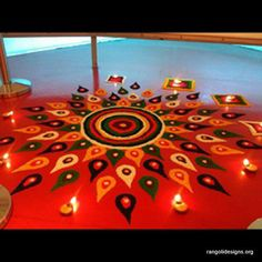 Beautifull orange rangoli design