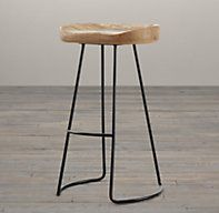 1950s Oak Tractor Seat Barstool - RH's 1950s Oak Tractor Seat Barstool:Inspired by a vintage tractor seat, our stool's scooped top is smoothly carved from solid oak and set on a sleek iron base. With a wink at rusticity, the dished seat lends warmth and wit to the minimalist design and offers long-sitting comfort, to boot.