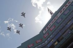 Fighter jets from the Vermont Air National Guard fly over Fenway Park prior to the Boston Red Sox facing the Tampa Bay Rays on the home opening day in Boston, Friday, April 13, 2012. (AP Photo/Charles Krupa)