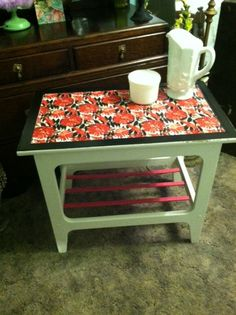 Distressed side table with fabic decopage and glass top.