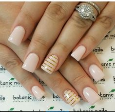 light acrylic nails with gold accent.