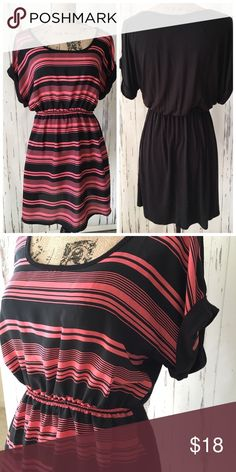 """Black and Coral Striped Dress Black and Coral Striped Dress   Little dress for summer or perfect as a beach cover up  Elastic waistband  Fabric 100% Polyester  Slight high-low hem   Length 19"""" with the front  being a bit shorter Dresses"""