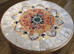 Mosaic Mandala                                                                                                                    private commission 40 inch diameter                                                                                                                         mosaic coffee table © 2005 by Artist Therese Desjardin Studio