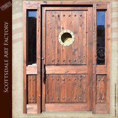 Nautical marine inspired doors - custom wood doors features a genuine portal window from the USS Mispillion and hand crafted nautical mooring designed door handles