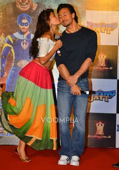 So cute! Jacqueline Fernandez kissing Tiger Shroff on the cheek at an event for their movie A Flying Jatt. via Voompla.com