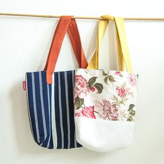 Practical and nice tote bag upstyled from African mudcloth and African batik fabric. The perfect gift for birthdays, mother's day, back to school. Handmade with love in Switzerland. Click to see more!