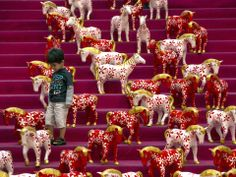 A boy walks among horse statues at a shopping mall decorated for the Chinese New Year of the Horse in Kuala Lumpur, Malaysia.