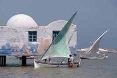 "ouilavie:  "" Bruno Barbey. Tunisia. Djerba island. 1990. Sailboats in the water.  """