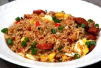 Arroz Chaufa -Peruvian Fried Rice:  Rice, eggs, meat, red pepper, soy sauce, oil, scallions, and ginger.