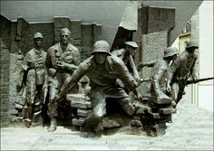 The Warsaw Uprising monument was unveiled on Krasinski Square, a site of fierce fighting, on August 1, 1989. It was designed by Professor Wincenty Kucma and architect Jacek Budyn and erected with donated funds. It consists of two groups of sculptures. This group depicts an attack by an insurgent unit.