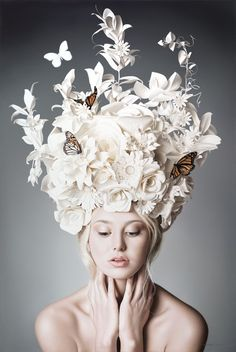 Like the way different flower shapes and butterflies have been used to create a beautiful flower crown. Could use this for either a shape for a hat or details