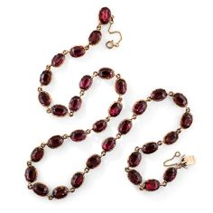 Georgian Garnet Necklace. Circa 1800. A gorgeous and glistening, darkly romantic necklace aglow with 33 foil-backed, deep raspberry-hued garnets set in 9K rosy-yellow gold collets, hence very likely of British origin. A classic.