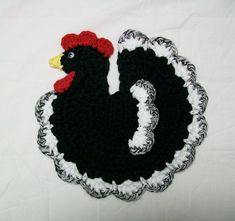 HandmadeBlack & White Rooster Chicken Potholder. Made from 100% cotton yarn. Chickens eye is a plastic wiggle eye. Machine washable; lay flat to dry. Measures 8 x 7.5. Color: Black, White, Red, & Yellow with a black & white variegated trim. Double thick with a hanging loop on the back. Brand New & Ready to ship. Designed and crocheted by me in a non-smoking home. Custom order are also welcome if you would like this in a different color.