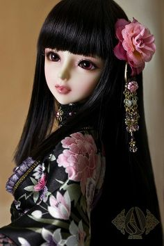 Doll with long shiny black hair. Very Asian!