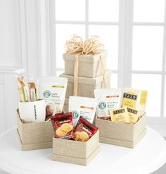 Starbucks Simply Natural Tower - WebGift  Price: 64.90    This sophisticated tower is full of sweet surprises. Enjoy a freshly brewed cup of Starbucks House blend, Breakfast Blend Coffee, or Caffe Verona in a Starbuck ceramic mug. Also includes a box of Tazo Calm Tea, crunchy biscotti and shortbread cookies. You'll want to share this exquisite gift!